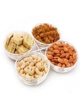 Punjabi Ghasitaram Diwali Hampers Silver Spiral Bowls With Chcolates And Dryfruits