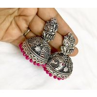 Temple jhumkis in silver finish - ME085