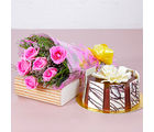 Giftacrossindia Six Pink Roses Hand Tied Bouquet with Half Kg Round Chocolate Cake (GAIMPHD0589)