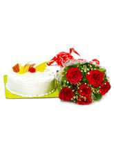 Giftacrossindia Pineapple Cake With Red Roses Bunc...