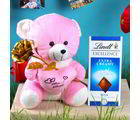 Giftacrossindia Golden Rose With Teddy Bear Holding A Heart And Lindt Chocolate (GAICOUVAL2019140)