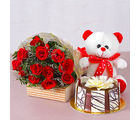 Giftacrossindia Bunch of Twelve Red Roses with Bear and Chocolate Cake (GAIMPHD0595)