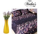 Aapno Rajasthan Dashing Black Bedsheet And Purple Artificial Flowers Set