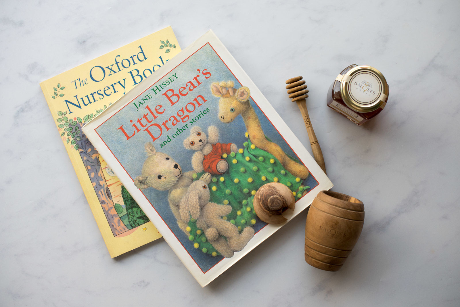 a pot of raw honey and some children's books